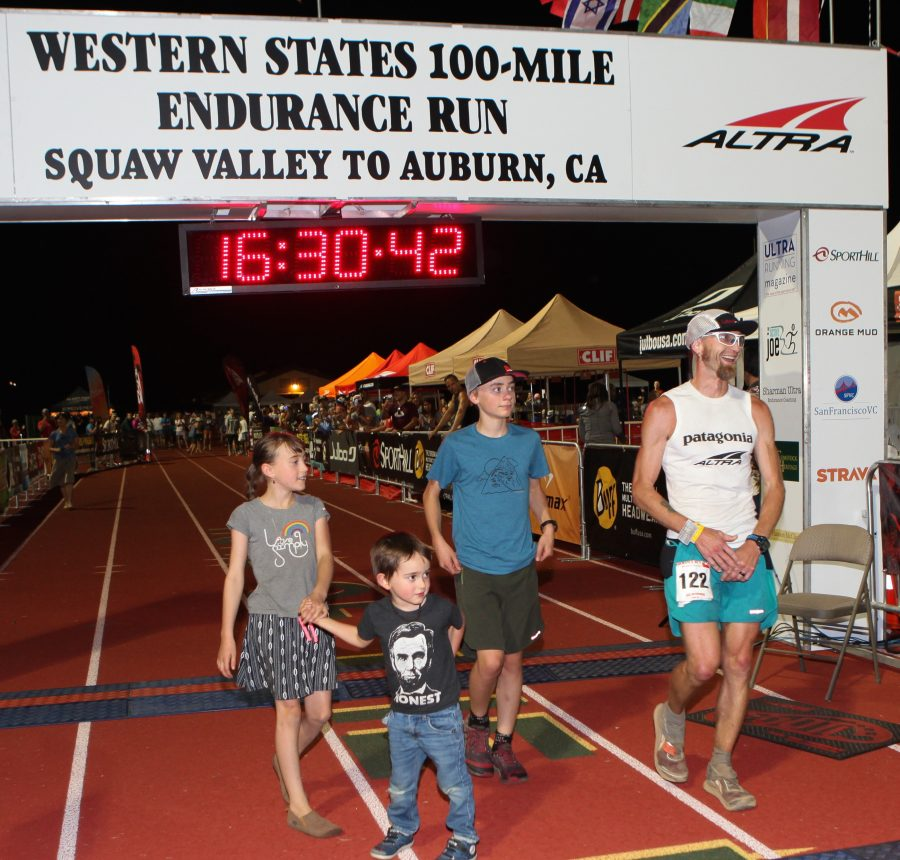 Altra Elite Athlete Jeff Browning took third place at the 2016 Western States Endurance Run, crossing the finish line with his children, from left, Annie, Abraham, Benjamin. Photo credit: Joe McCladdie